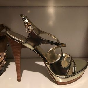 Guess by Marciano gold heels with dark wooden heel